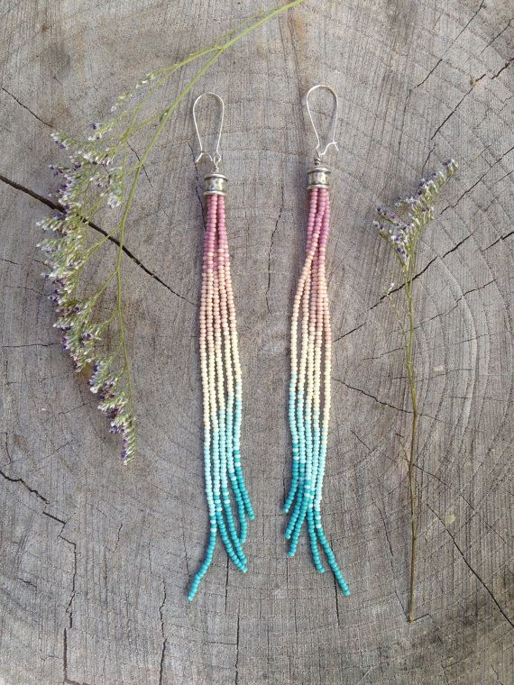 Long Beaded Earrings, Seed Bead Earrings, Boho Earrings, Southwestern Earrings, Tassel Seed Bead Earrings, Long Fringe Earrings.....  ♥ Beaded earrings measuring approximately 6 3/4 L. Five strands hang delicately from one large silver brass cone giving these seed bead earrings a nice flow as they hang. These earrings known as shoulder dusters have a beautiful ombre pattern featuring gorgeous spring colors of silk pink, ivory, baby blue and a darker blue. They are made using quality Czech…