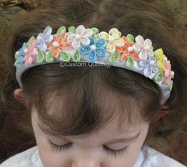Here's a cute quilled headband designed by DT Sonya