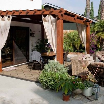 Pergola With Curtains On Patio Outside Spaces