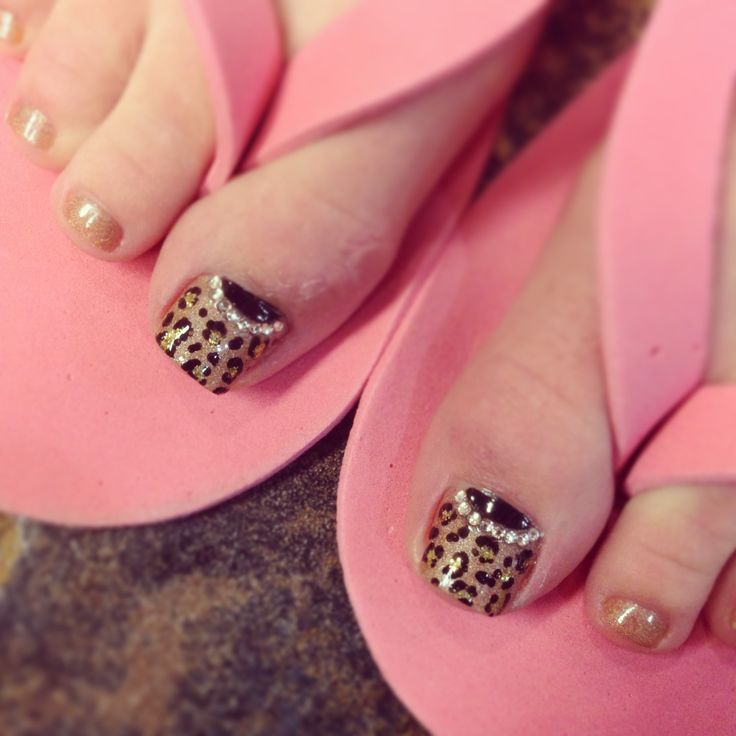 Leopard toe nail design with half moon rhinestones