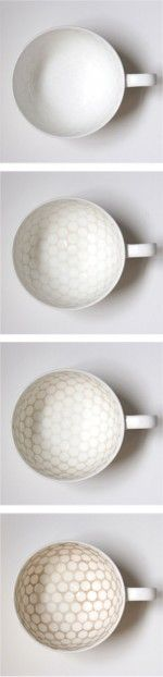 British artist Bethan Laura Wood (www.woodlondon.co.uk) has designed her bone china cup series titled Stain to improve through use. Each cup is treated so that areas are susceptible to stain in a predetermined pattern. Through use, the pattern is revealed and the user's individual drinking habits are built up over time.