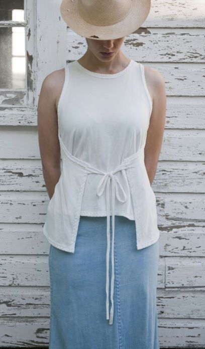 Alabama Denim Maggie Top  100% hand-sewn organic cotton jersey pull-on top with tie closure. Cinches at the waist and flares slightly to hem. Indigo colors are hand-dyed in naturally grown, local indigo. Choose your color below. By Alabama Chanin.