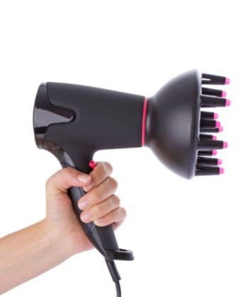 The Top 10 Fixes for Frizzy Hair - Buy a Souped Up Blow Dryer  Ionic dryers do make a difference. They reduce frizz by compressing the cuticle, which locks out puff-inducing moisture. We like the Conair Comfort Touch Tourmaline Ceramic Styling Blow Dryer—a steal at under $35. Just be sure to add a diffuser or Hot Sock to the end of any dryer you use, and to dry on the coolest setting.