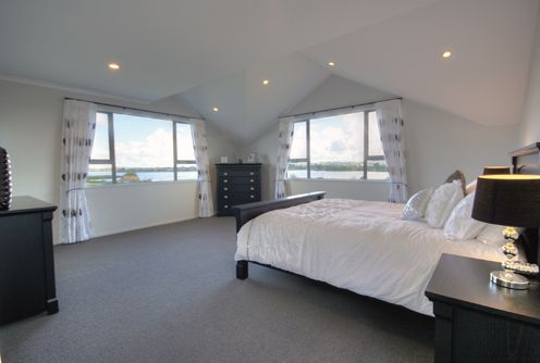 The huge master bedroom on the top storey, features interesting ceiling contours, with the usual ensuite bathroom and walk in wardrobe.