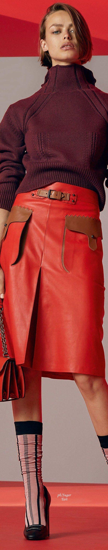 Bottega Veneta R-18: burgundy sweater, red leather skirt.