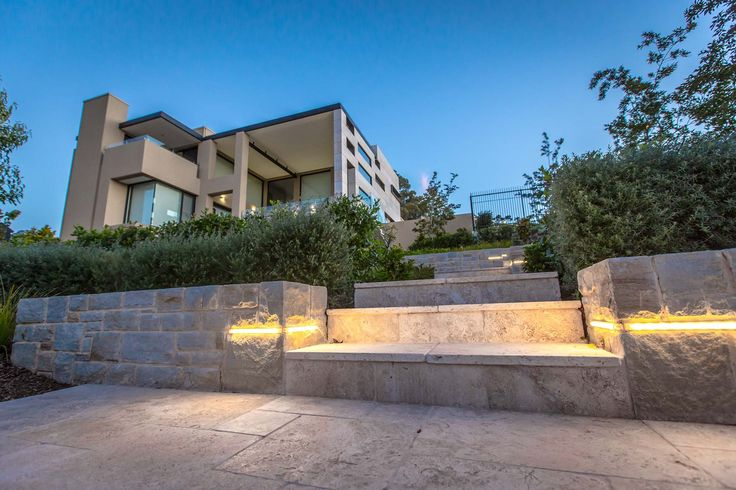 Mitcham residence - Hand crafted sand stone wall lighting