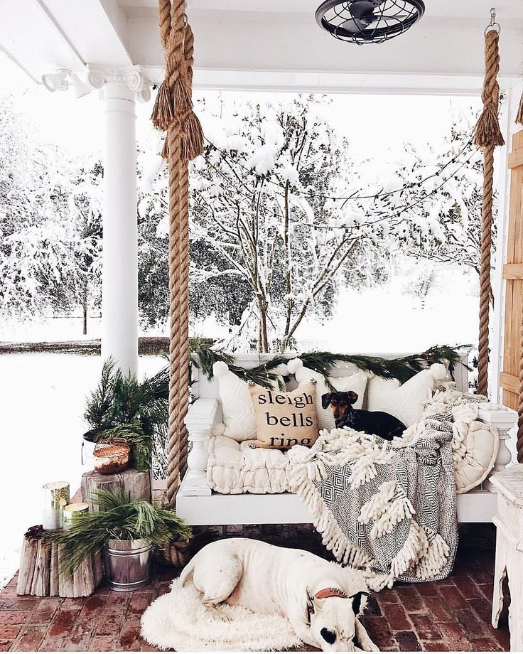 Oh my goodness!!!! I'm having the BEST TIME creeping the #cottonstemheartsfarmhousechristmas hashtag tonight. Seriously you guys there is so much inspiration there. I'm so glad Erin @cottonstem invited me to co-host this week & I'm so thankful for everyone who has been sharing their farmhouse Christmas decor. This porch from @cindimc.ivoryhome gives me all the Christmas farmhouse vibes & you know I'm loving those pups!! I wish I could snuggle them on that cozy porch swing. Isn't...