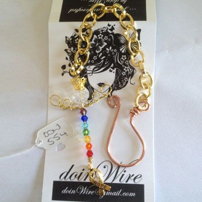 doinWire handcrafted Car Mirror Suncatcher. Gold tone craft wire angel with chakra crystals and Awareness charm. DOW554