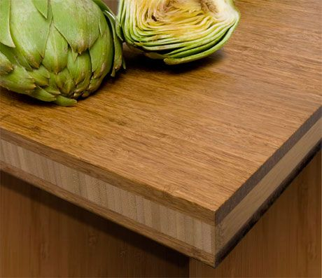 Bamboo countertop -- 16% harder than maple, often used for  cutting boards -- re-harvestable every 4.5 years. An 8′ x 4′ sheet of 1 inch bamboo plywood will set you back only $245.