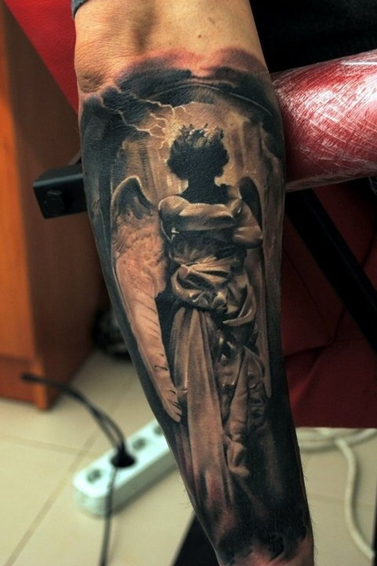 Dark angel tattoo on arm