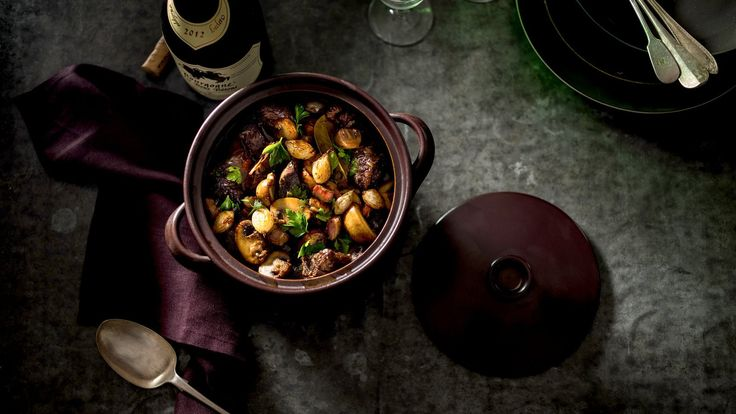 Like coq au vin, its sister dish from the Burgundy region of France, beef Bourguignon is a stew of meat slowly simmered in hearty red wine along with pearl onions, mushrooms and crisp, cubed bacon Use a good wine here, something simple but drinkable It makes all the difference in the finished dish