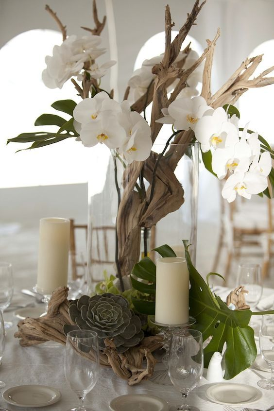 orchid driftwood wedding centerpiece / http://www.deerpearlflowers.com/driftwood-wedding-decor-ideas/2/