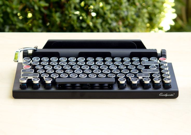 Qwerkywriter is a bluetooth enabled, typewriter-inspired mechanical keyboard that simulates a tactile clicky feel of a vintage typewriter. It features custom typewriter-inspired keycaps and an integrated tablet stand.