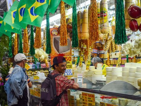 Man at a Brazilian Market Photo by Daniel Moore — National Geographic Your Shot
