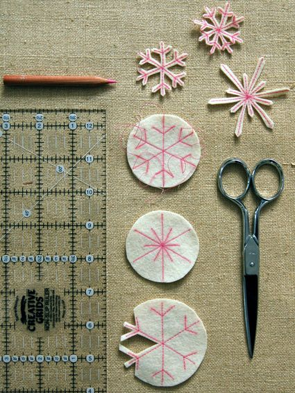 Stitched Felt Snowflake Ornaments (from Stocking Tutorial) @the Purl bee: There are two methods below to make the snowflake pattern on the felt. 1) Iron-on Transfer Pencil Method, 2) Freehand Method...