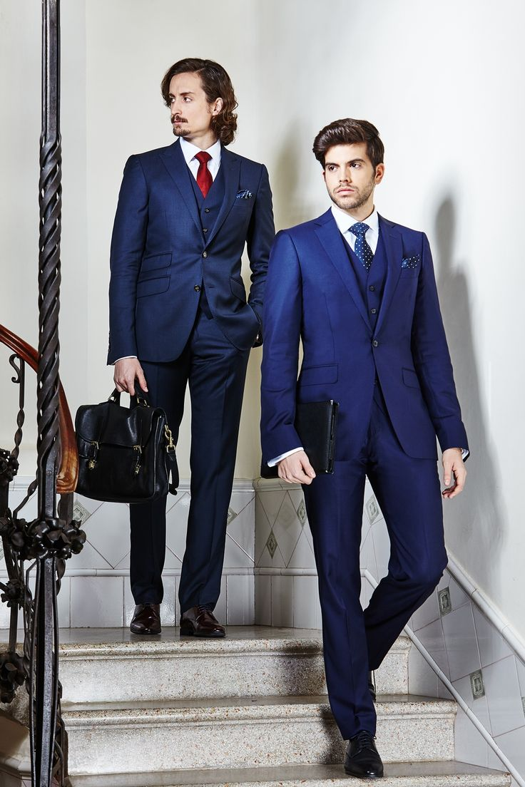 Men's contrast blue tailored three-piece suits.