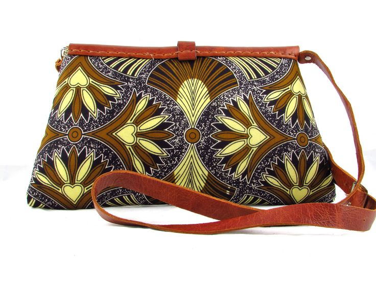 Dalia by FUNDI is stylish handbag, handcrafted from leather and traditional African fabric.Available at Modern Tradition - Where tradition meets today!