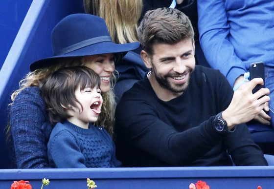 In between nail-biting matches, Piqué tried to create a lasting memory with a family selfie. But instead of following mom and dad's lead by flashing his pearly whites, Milan decided to make his own unique face.  What do you call the mouth open, tongue out look? Oh, that's right. Adorable!