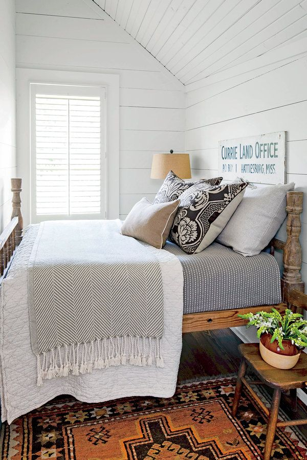 Montagle Home BedroomThe Master Bedroom Assorted calico and checked patterns are a nod to the past yet feel completely contemporary. Just follow Halvorson's lead by tempering them with classic cottage white, and you can't go wrong.