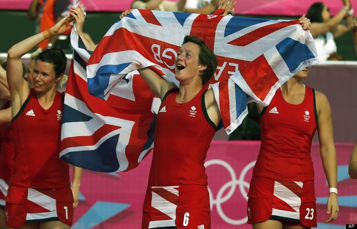 Britain's Hannah Macleod, center, celebrates along with her teammates after winning the women's field hockey bronze medal match against New Zealand at the 2012 Summer Olympics, Friday, Aug. 10, 2012, in London.