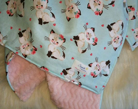 Kitten baby blanket with a soft plush fleece on the back.