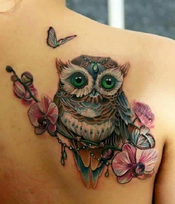 An Owl Sitting on Orchid Twig. Jeweled owl sitting on the twig of orchids makes a perfect tattoo for all the females.