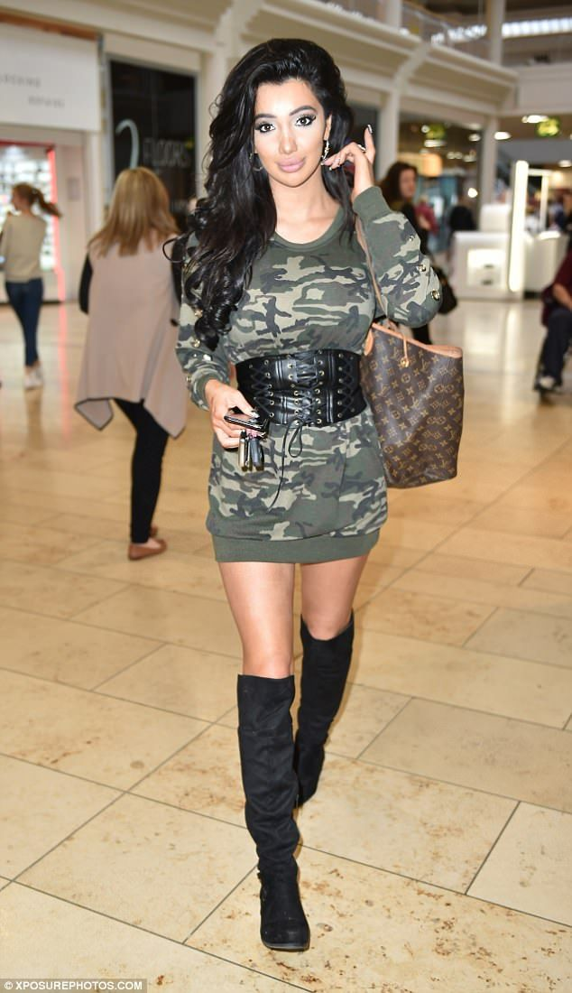 Ladylike? Chloe Khan attempted her very own take on demure during a promotional trip to Newcastle on Saturday when she was flogging teeth whitening products in the city's Metro Shopping Centre