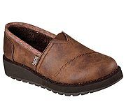 """Put more comfort between you and the cold with the SKECHERS BOBS Keepsakes High - Snow Spell shoe. Smooth faux leather upper in a slip on casual comfort alpargata with faux fur lining and Memory Foam footbed. Subtle wedge heel. <br><b>BOBS helps make a difference for animals and kids - learn more <a href=""""https://www.skechers.com/en-us/bobs-for-dogs""""> here.</a></b>"""