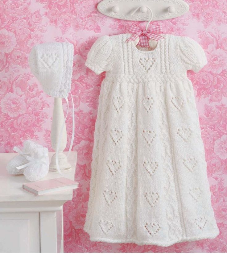 Knitting Pattern for Love and Kisses Christening Gown Set - A heart lace motif and x kiss cables decorate this christening gown, bonnet, and booties set. One of 4 sets in the Elegant Ensembles to Knit 2 ebook.