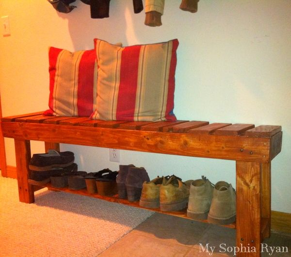 Rustic bench made from wood pallets.