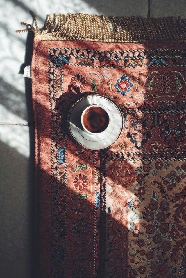 Coffee and beautiful rug