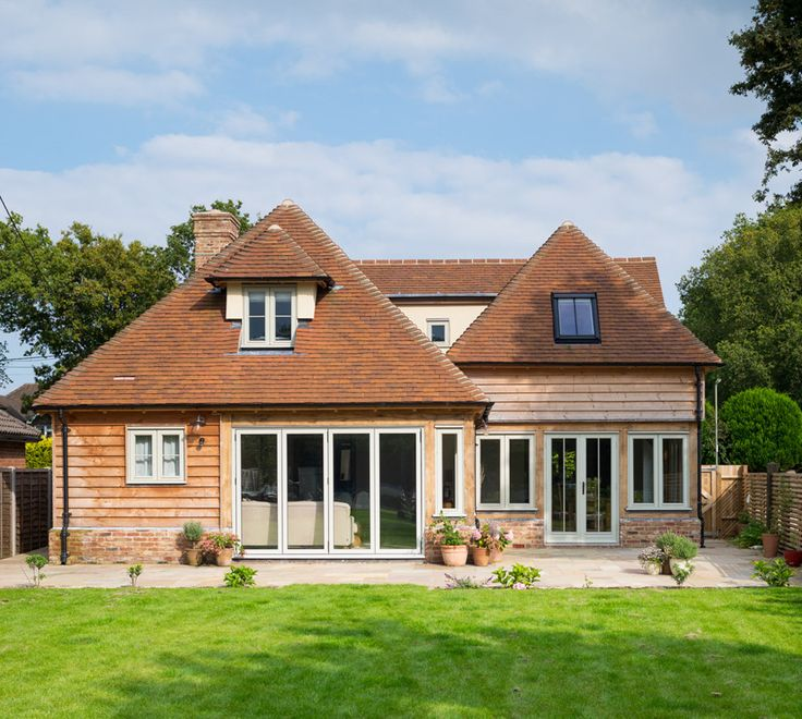 weatherboarded cottage with painted bi fold doors