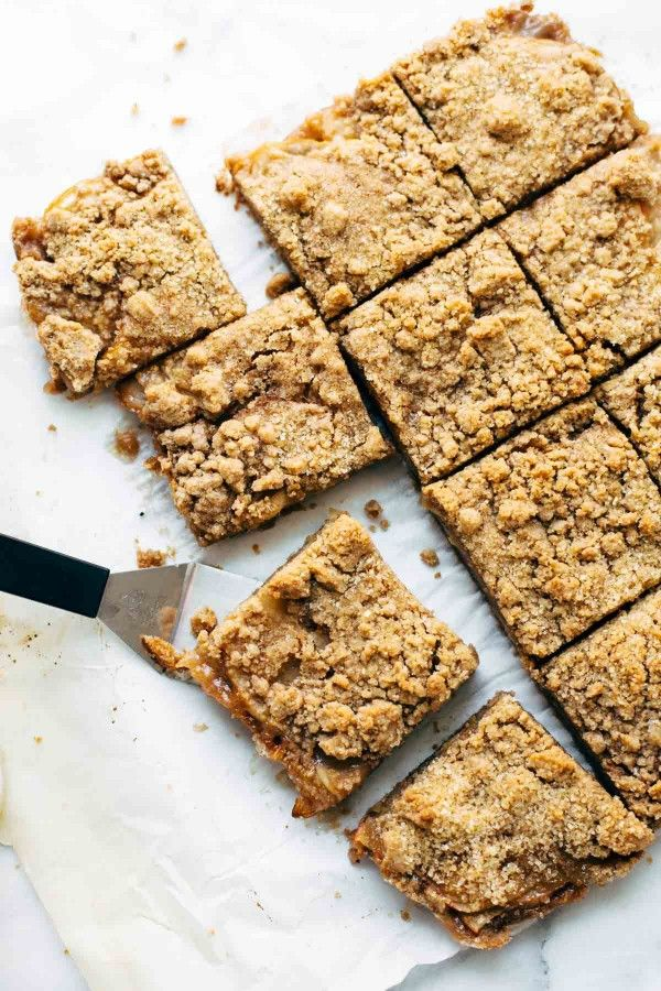 Addicting Caramel Apple Crisp Bars - these layered bars are so simple! loaded with homemade caramel and apples. ♡ | pinchofyum.com