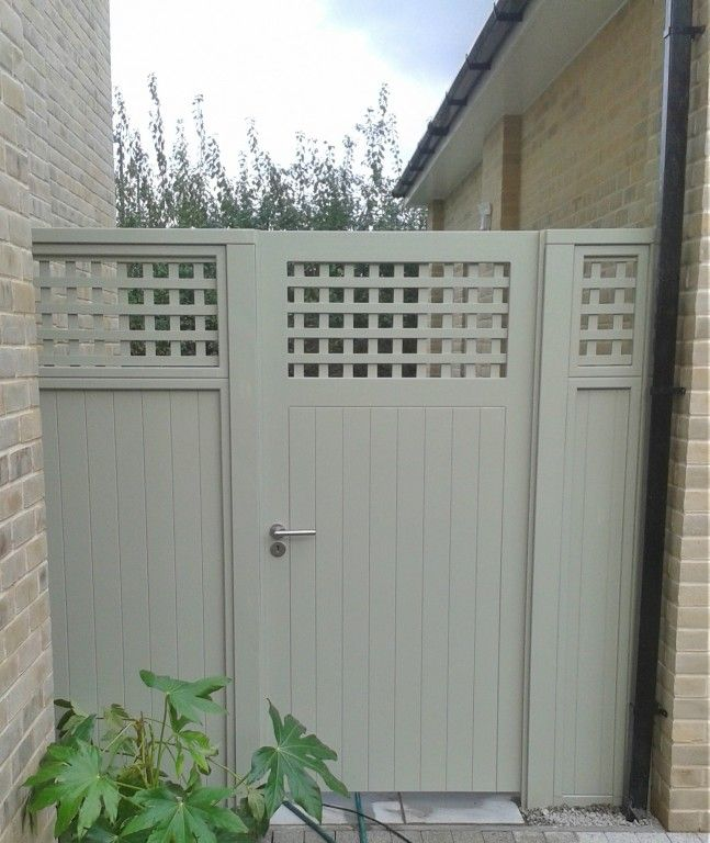 Solid painted gate with trellis top