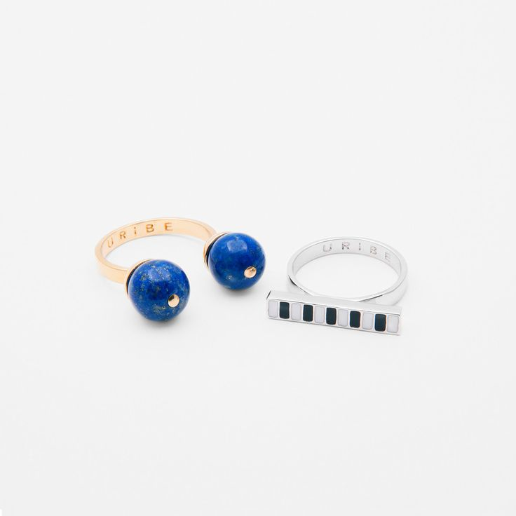 "Two ring set; One 18K gold plated open ring with 9mm Lapis Lazuli ""eyes"", and one rhodium plated ring with black and white enamelled ""teeth""."