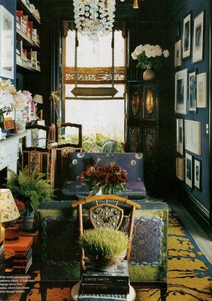 A beautifully bohemian room, in a dark teal.
