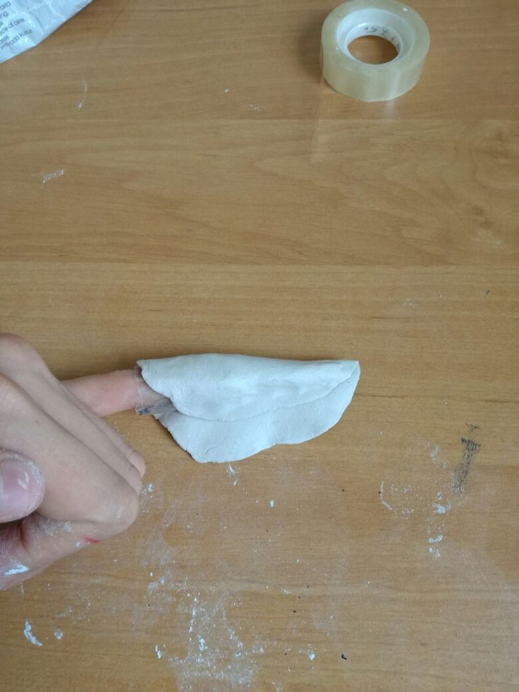 "Then take a piece clay or worbla and cover it with it, cut off the rest of the material and try to smooth it out  Its hadr but try to wett your fingers it should work :""D"