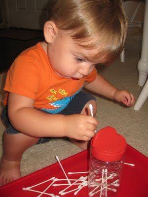 Practicing fine motor skills - Qtips into spice shaker jar