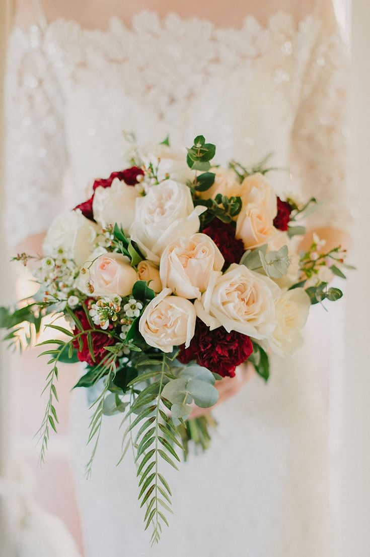 Romantic wedding bouquet with white and peach roses, burgundy carnations and soft green foliage | Sophie Baker Photography