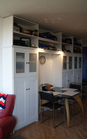 Built-in - Re-purposed flat pack shelving units. Added doors and upper shelves.