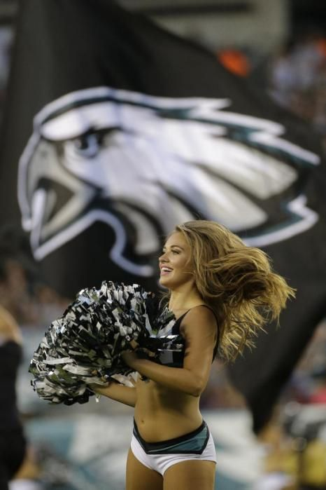 NFL cheerleaders - Preseason week 2 - A Philadelphia Eagles cheerleader performs during the first half of a preseason NFL football game against the Baltimore Ravens, Saturday, Aug. 22, 2015, in Philadelphia.