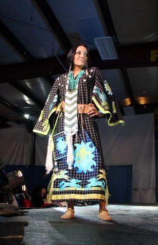 Karina White of Akwesasne models a traditional outfit, designed by Niio Perkins  (Haudenosaunee). Photo by Randi Rourke Barreiro
