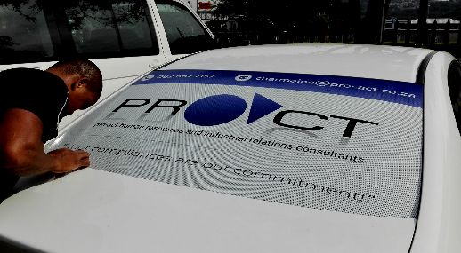 Attention to detail. Saki carefully applying econoline solvent printable one way vision onto client, Pro-Act HR & IR Consultants', vehicle. #vehiclegraphics #vehicle #graphics #branding #brand #contravision #marketing #business #Proact #printing #IgniteYourBrand #brandactivation #UmliloBrands