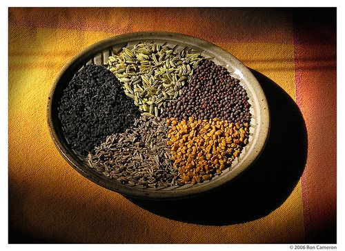 A selection of spices used in Bengali panch phoran. Clockwise from top: fennel seed, mustard seed, fenugreek seed, cumin seed, and kalonji seed
