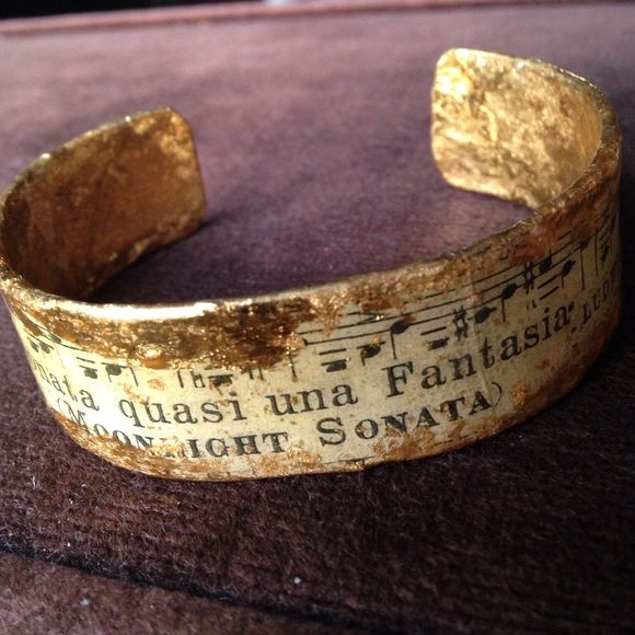 "On Trend Evocateur Cuff Bracelet Highly sought after and prized hand made cuff bracelet. Brass base for strength with burnished gold leaf and music notes and bar image transfer and clear enamel seal. Each piece entirely unique and one of a kind!! This cuff approximately .75 inch thick and 2.5 inches diameter and has Beethoven ""Moonlight Sonata"" bar image. Treat yourself or a wonderful gift for birthday, Mother's Day, a music lover or  someone very special!!! Evocateur Jewelry Bracelets"