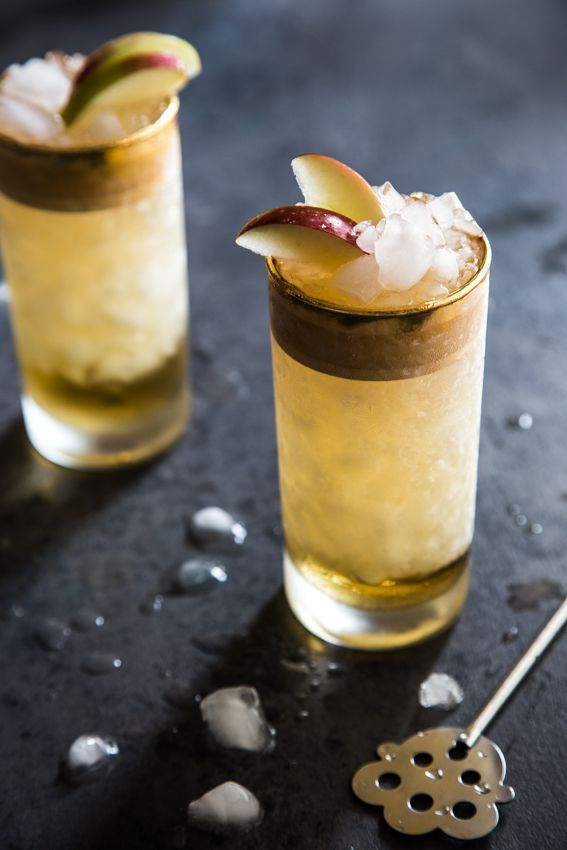 Richly spiced rum and tangy hard apple cider come together in the ultimate summer/fall cocktail mashup: The Apple Cider Swizzle.