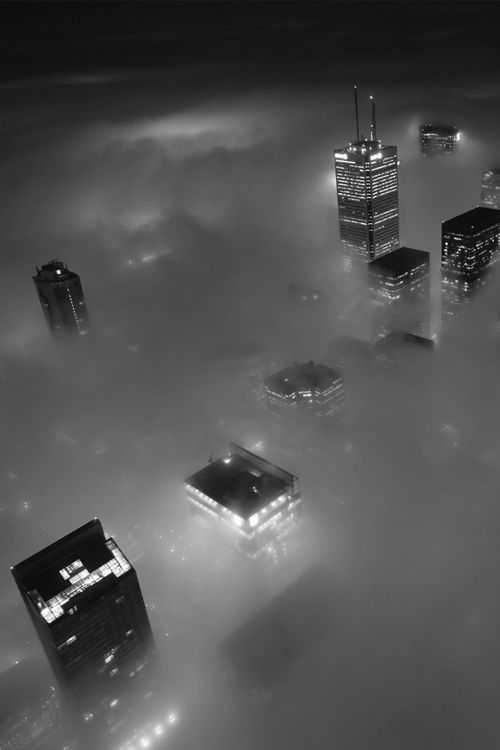 NYC at night in fog. Wow. I wish I knew the photographer