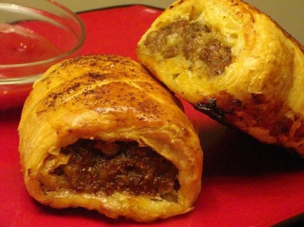 Sausage Rolls the Australian Way. 1 (17 1/3 ounce) package puff pastry 2 lbs bulk pork sausage 1 medium onion, finely chopped 1 cup breadcrumbs salt and pepper	 (to season) 1/2 cup milk or 1/2 cup cream 1 egg, beaten with 1 tablespoon water