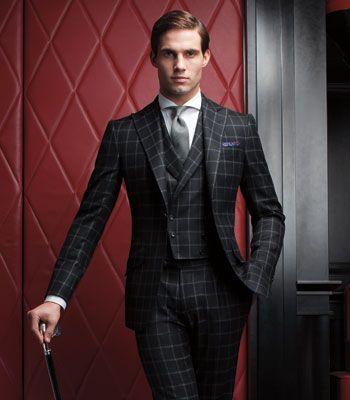 Well tailored windowpane suit.