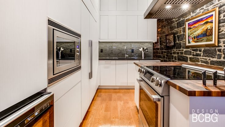 Modern kitchen style with maple cabinets painted with white lacquer.
